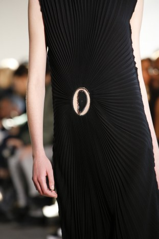 Agate as centre of attention in a stunning sun-ray pleat dress